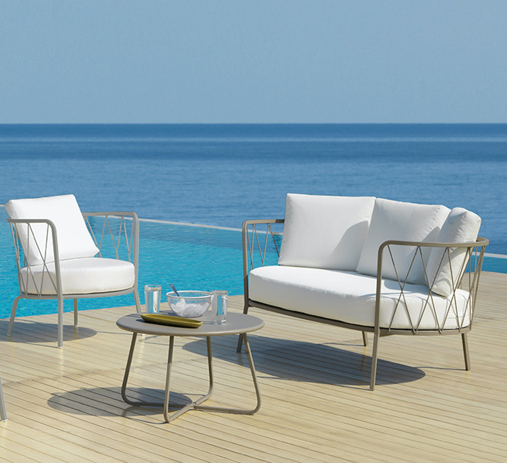 metal outdoor sofa with white cushions