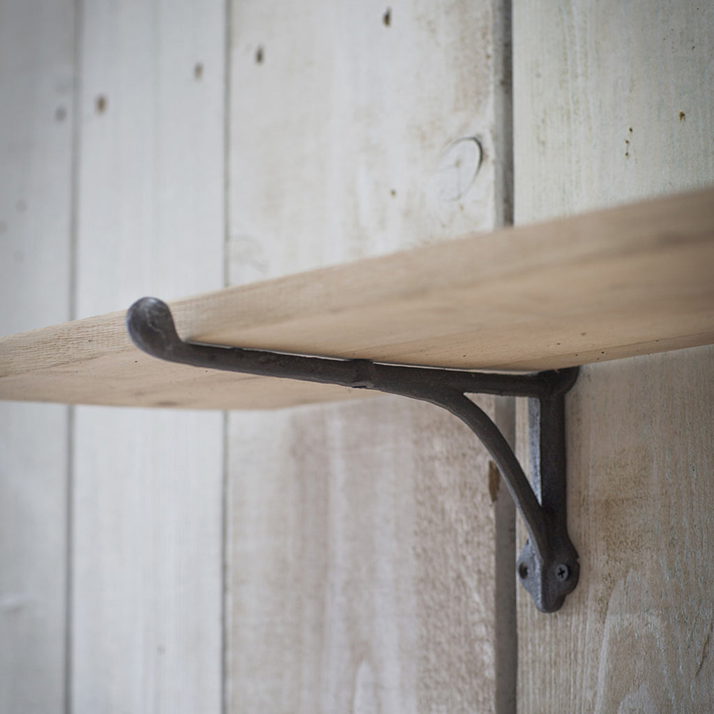 oak shelf with iron brackets