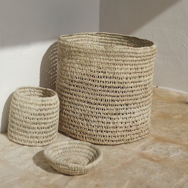 woven palm leaf storage basket by Tine K home