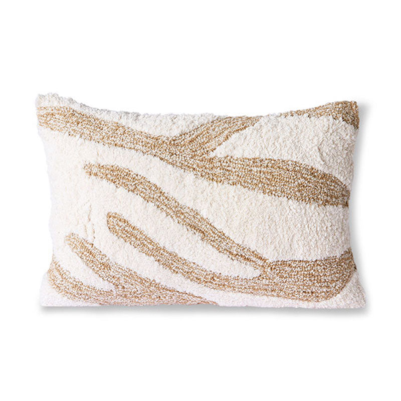 Fluffy white and beige cushion with a swirl pattern