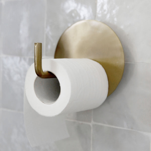 brass toilet roll holder in a simple modern style