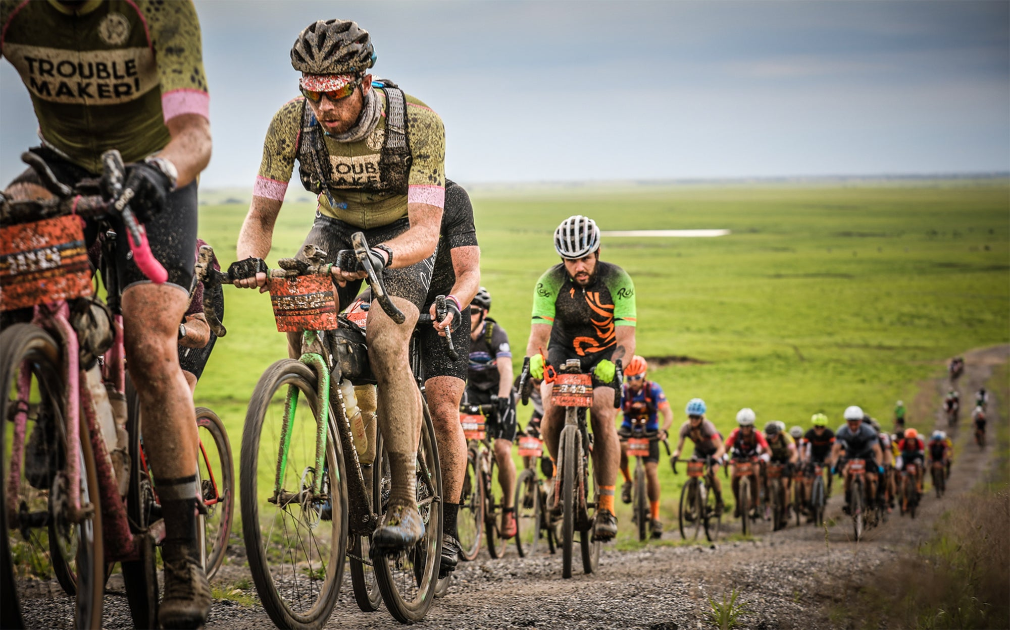 The Dirty Kanza peloton covered in mud