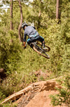 rider jumping with IRC tanken enduro mtb tire