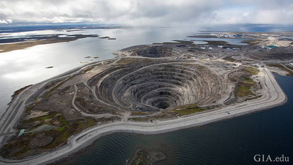 Diavik diamond mine summer A154 dike and open pit. To safely open-pit mine its ore bodies, extinct volcanoes located just offshore under the lake waters, dikes were built. Courtesy: Copyright © 2016 Rio Tinto