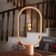 Load image into Gallery viewer, HZFCEW Heng Balance LED Table Lamp Ellipse Magnetic Mid-air Switch USB Power Warm White Eye-Care Night Light Decoration - thegsnd