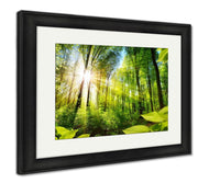 Framed Print, Scenic Forest Of Fresh Green Deciduous Trees Framed By Leaves With The Sun-Framed Print-Ashley Art Studio-thegsnd