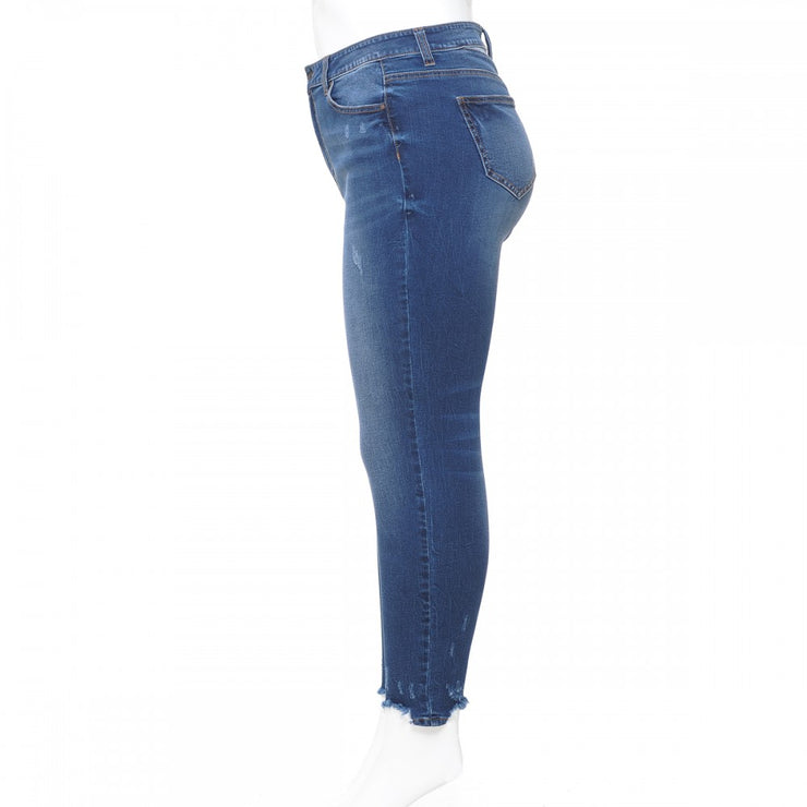 HIGH-RISE ANKLE SKINNY WITH CHEWED HEM AND BACK YOKE DETAIL
