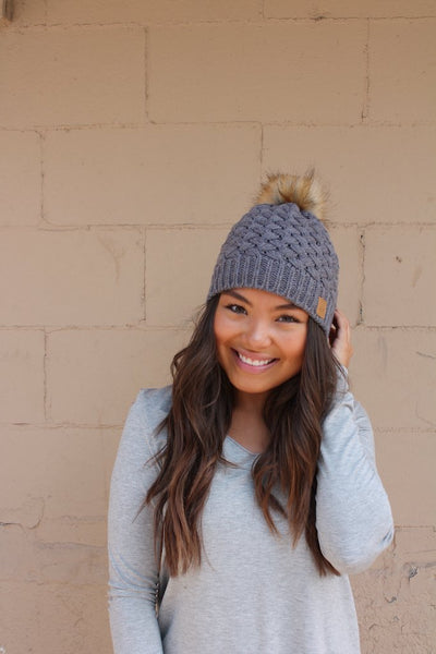 Grey basket weave knit hat with pom accent