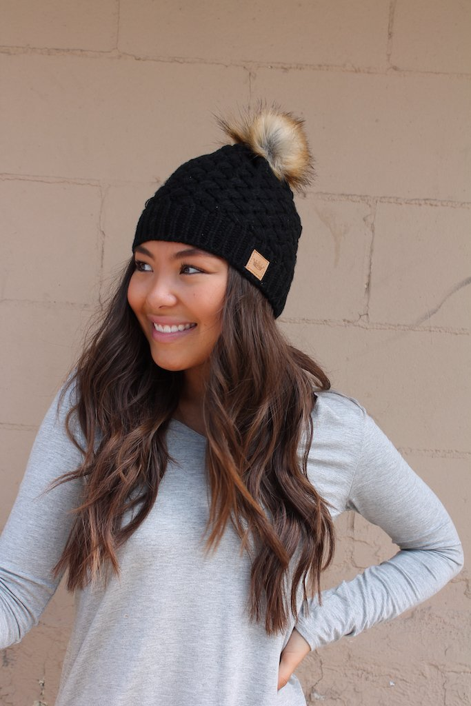Black basket weave knit hat with pom accent