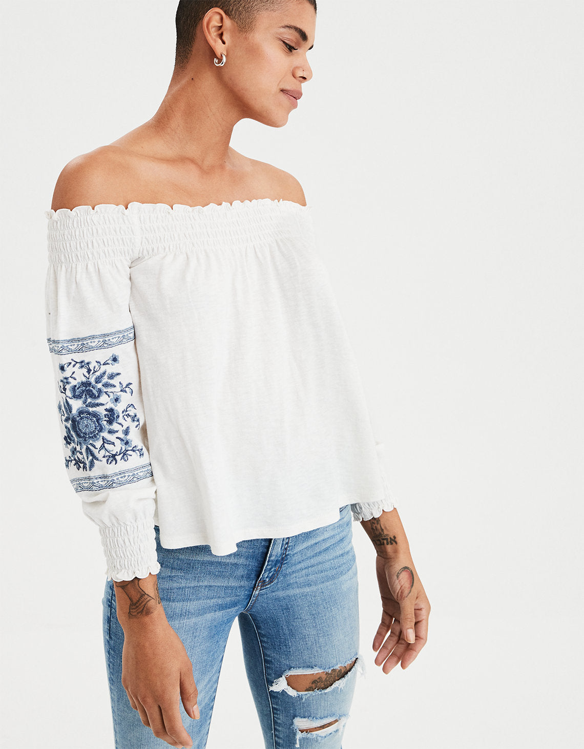 5d752ab76aa American Eagle | AE Smocked Off-the-Shoulder Top in Cream | American ...