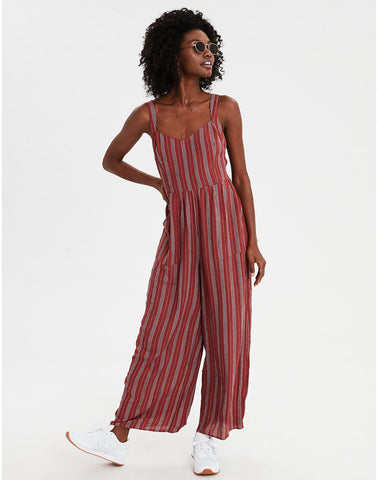 377c31ed60b0 AMERICAN EAGLE AE Tie Waist Striped Jumpsuit in Faded Red