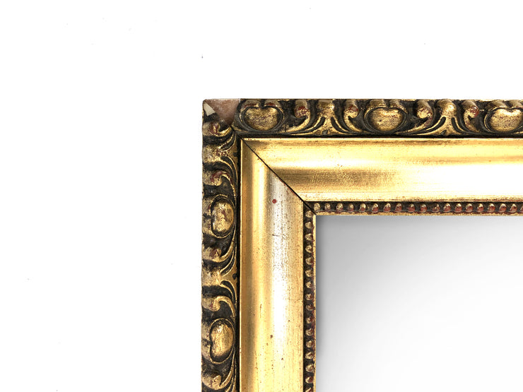 Mirror with golden frame