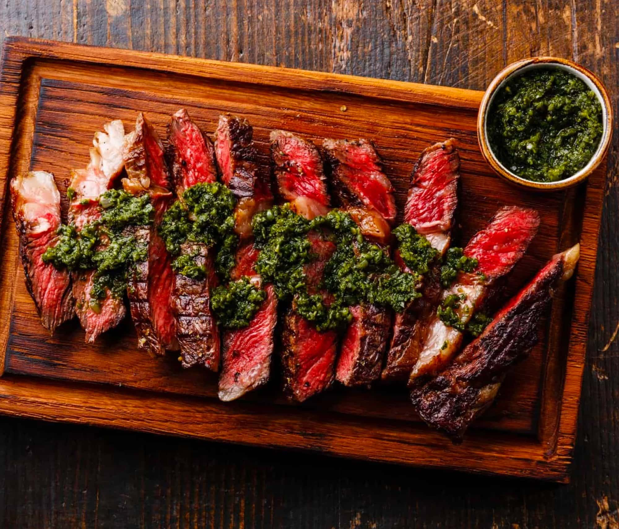 Chimcichurri Rib-Eye Steak on a plate cut into juicy pieces