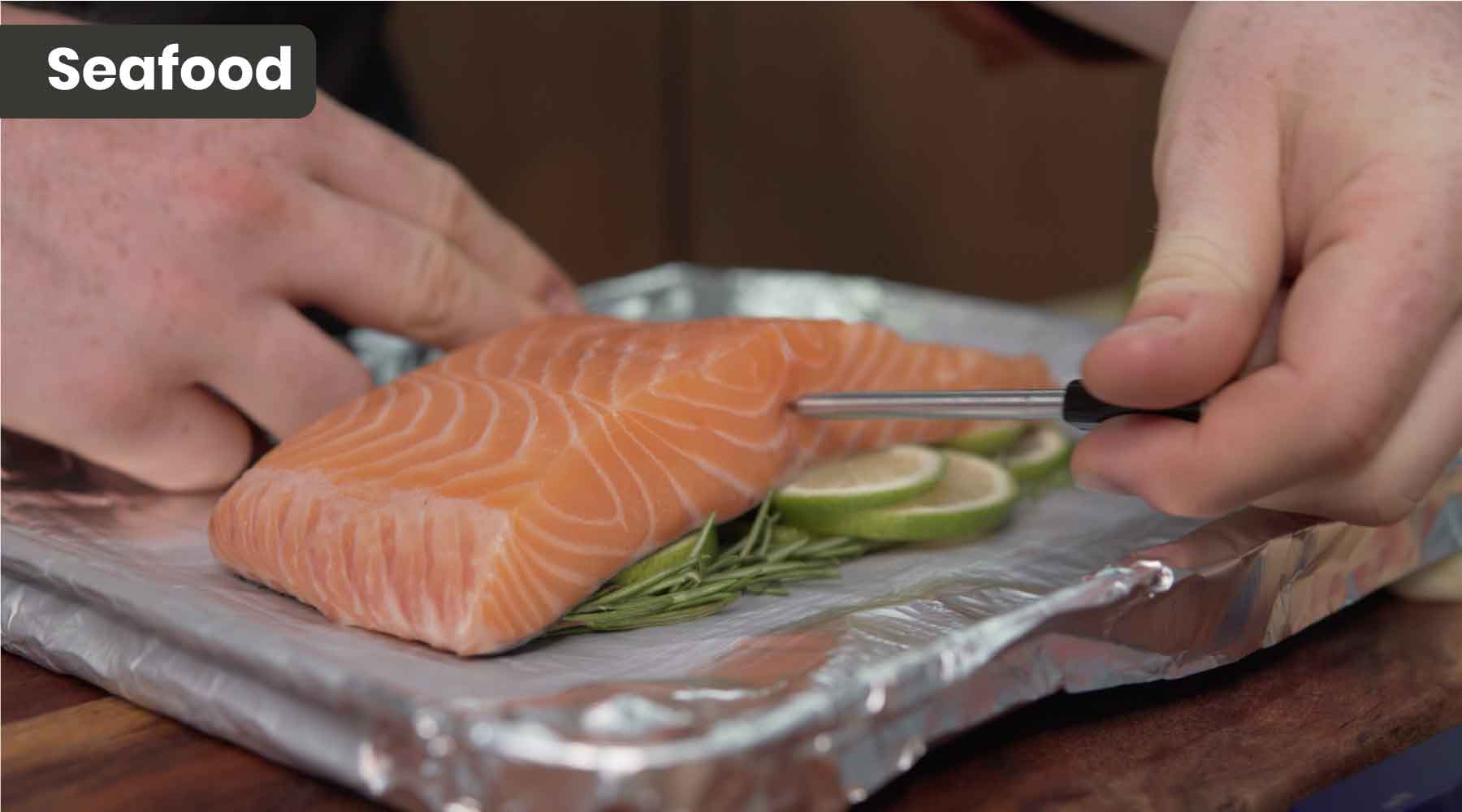 Inserting the meatstick inside salmon