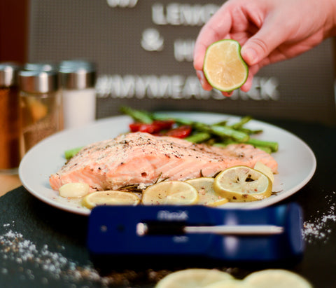 Lemon drizzled over salmon with The Mini