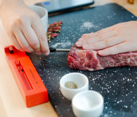 Inserting The MeatStick into a steak