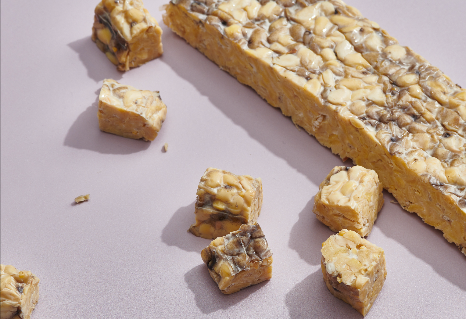 Tempeh, a versatile soy-based alternative protein product packing tons of vitamins and nurtients.