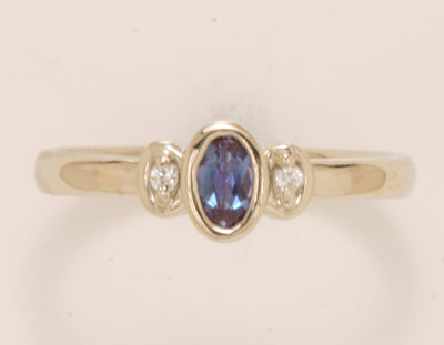 Bezeled One Stone Oval Mothers Ring With Diamond* Deisgned by Christopher Michael