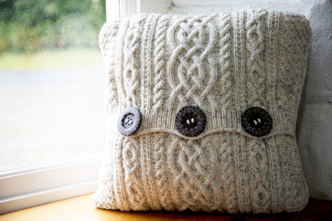 Aran-Knit Wool Cushions in Cream, Grey by Geraldine Gildernew