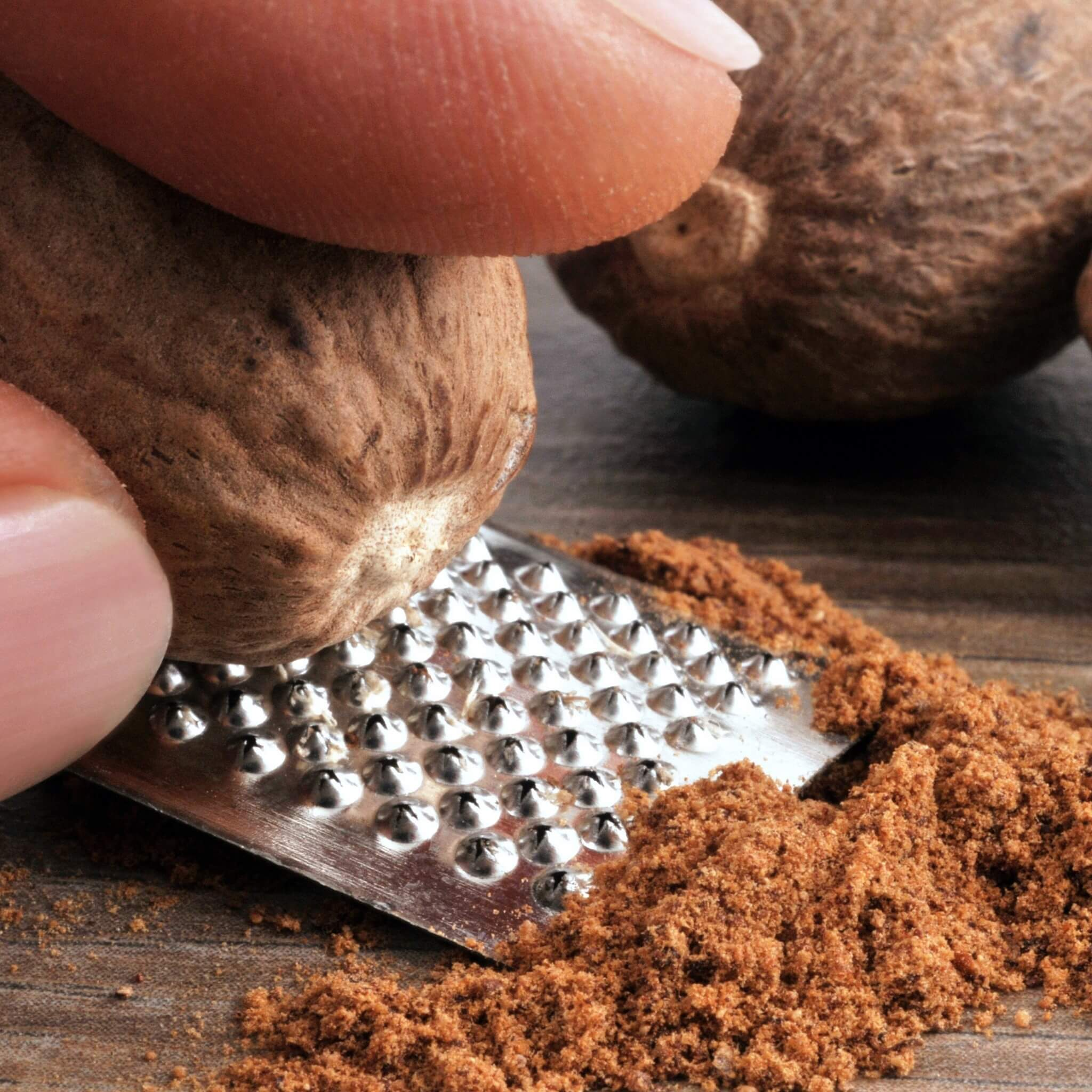 Grating a Cinnamon Tree Organics whole nutmeg