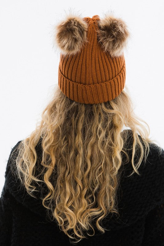 rust colour winter hat with 2 pom poms attached