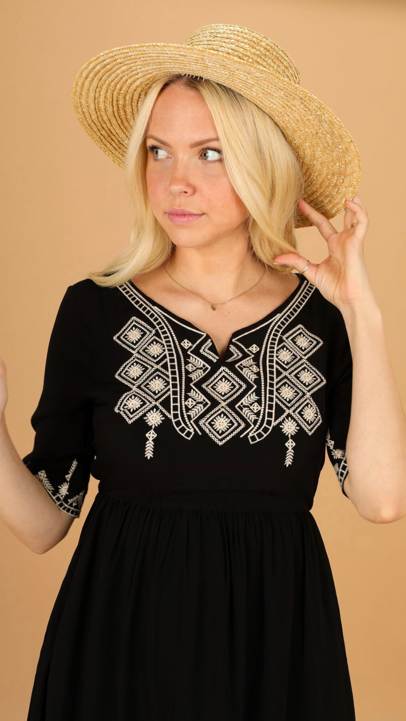 black embroidered knee length dress