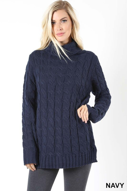 navy cable knit sweater with a cowl neckline