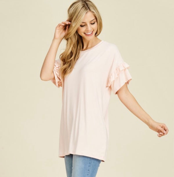 blush top with ruffle sleeve detail