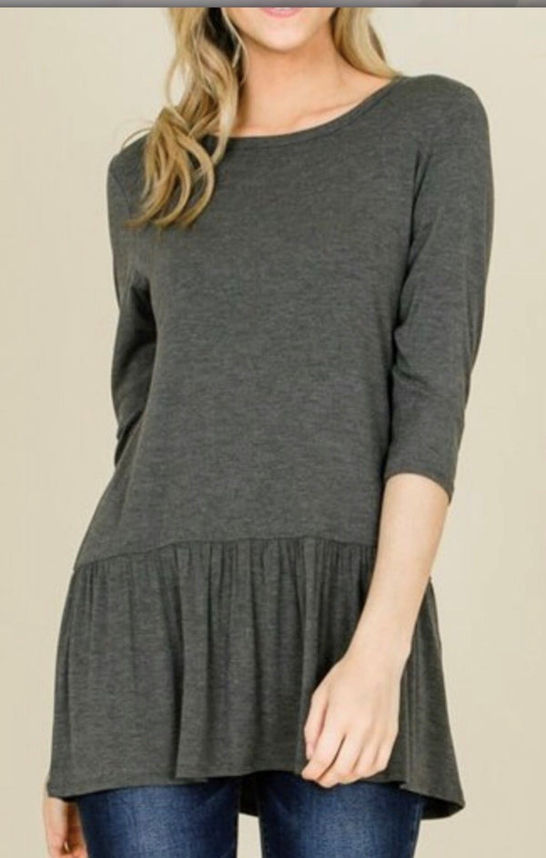 grey casual top with ruffle hem