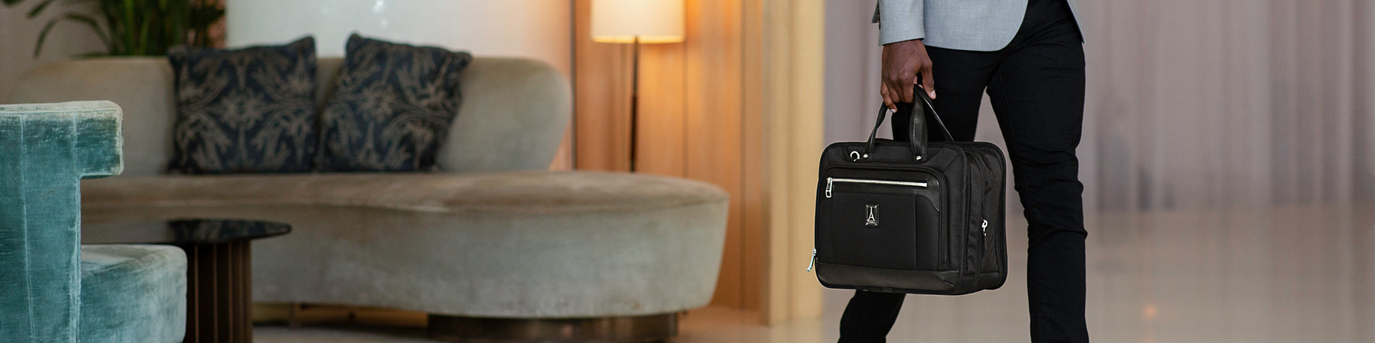 man holding a briefcase in hotel lobby