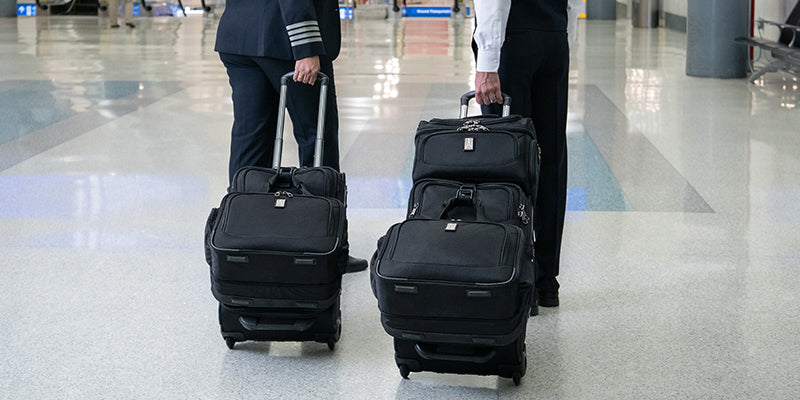 Flight attendents with rollaboard luggage at the airport