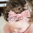 toddler wearing soft pink lace bow headband