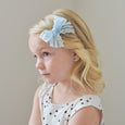 little girl with village baby blue lace bow clip
