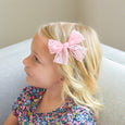 little girl with accessories Lucy pink lace clip in bow village baby