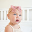 one year old wearing amelia lace bow headband