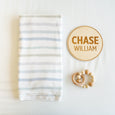 village baby stretch knit swaddle, custom name sign, and baby toy gift set