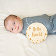 baby boy in starry dreams swaddle with star hellos world welcome sign