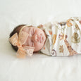 newborn peach lace harper bow on stretchy headband sleeping in safari animals swaddle