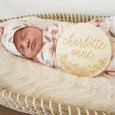 up close of baby with peach posey etched wood keepsake name gift