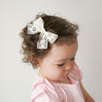 Toddler wearing Abigail lace ivory cream off white bow