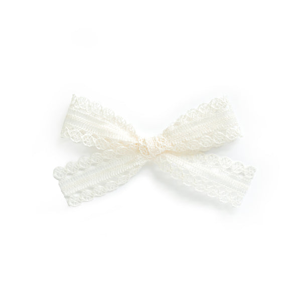 perfect ivory lace bow for babies and little girls by village baby june