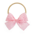 light medium pink pace bow on stretchy nylon headband for infant newborn baby Lucy