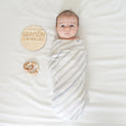 newborn photo with name weight date and length sign