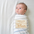 baby with hello my name is wooden badge sign birth announcement photo