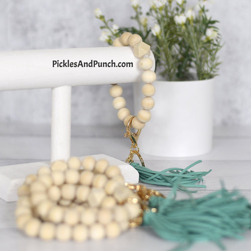 natural wood beads All beads are a natural wood Gold metal attachments for keys Teal tassel