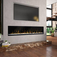 "Dimplex XLF74 Ignite XL 74"" Electric Fireplace mounted in a hearth wall under a tv"