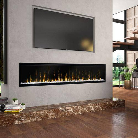 "Image of Dimplex XLF74 Ignite XL 74"" Electric Fireplace mounted in a hearth wall under a tv"