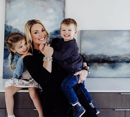 Jessica with family and paintings