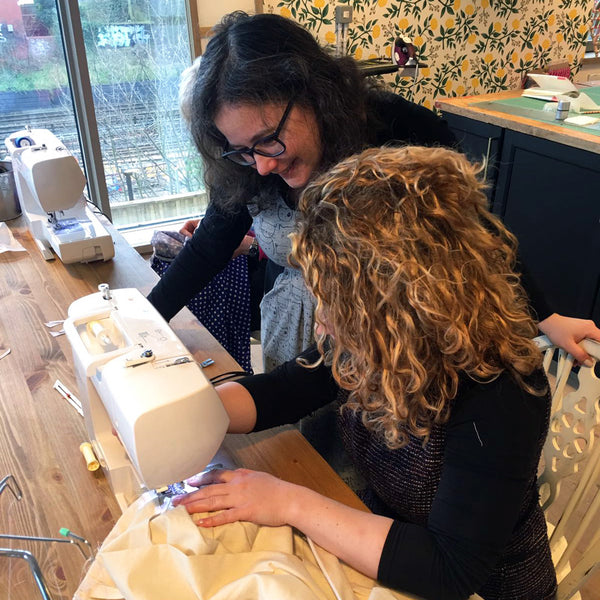 Charlotte Newland teaching a private sewing lesson