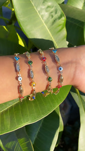 Guadalupe with evil eye bracelet